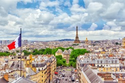 Beautiful panoramic view of Paris from the roof of the Pantheon. View of the Eiffel Tower and flag of France.