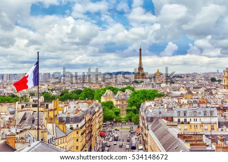 Shutterstock Beautiful panoramic view of Paris from the roof of the Pantheon. View of the Eiffel Tower and flag of France.