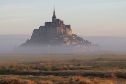 Beautiful panoramic view of the famous tidal island of Le Mont Saint-Michel estate, Normandy, Northern France