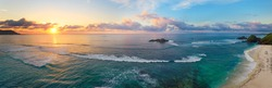 Beautiful panoramic view of tropical beach with surfers at sunset, Kuta, Lombok island. Indonesia