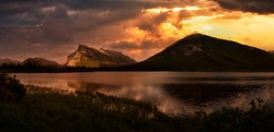 Beautiful Panoramic View of Vermilion Lakes in Banff, Alberta, Canada. Dramatic Sunset Sky Art Render. Canadian Mountain Landscape Background Panorama.