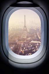 Beautiful paris cityscape from aircraft window