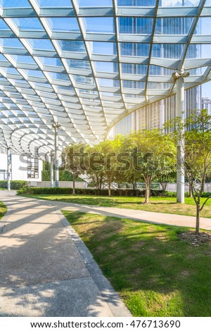 beautiful park and glass canopy at a sunny day #476713690