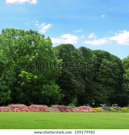 beautiful park with a beautiful flower garden and a green lawn