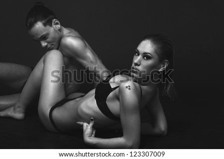 Beautiful passionate couple having sex on the floor posing