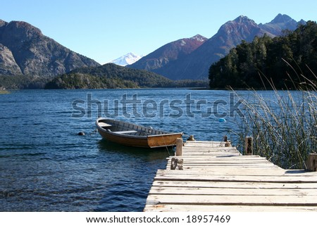 beautiful pastoral landscape with boat and peer
