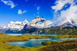 Beautiful Patagonia landscape of Andes mountain range, winding road and lake at Torres del Paine National Park, Chile.