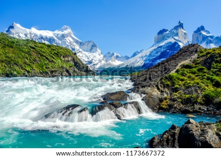 Beautiful Patagonia landscape photo at Salto Grande Waterfall with the Andes mountain range in the background at Torres del Paine National Park, Chile.  Foto stock ©