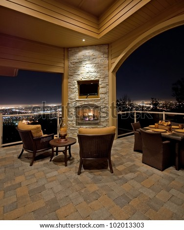 Beautiful Patio with View at Night Outside Luxury Home