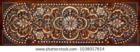 Beautiful patterns, wooden carved on the door. Eastern architectural decoration.