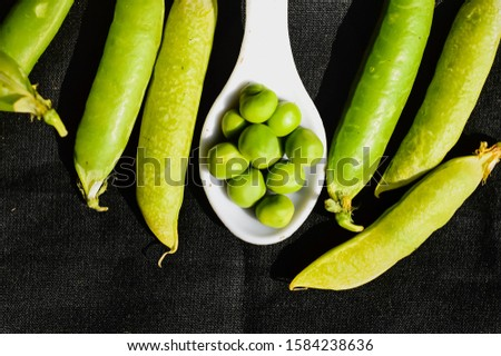 beautiful pea on black background, green pea on black background,healthy peas beans and white spoon in peas beans,