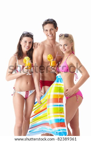 Beautiful people in bathing suits with a cocktail on a white background