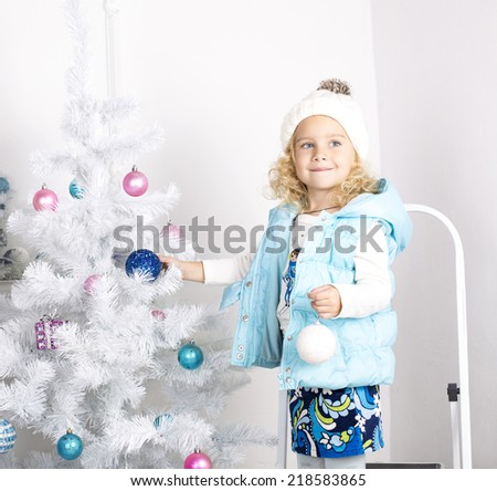 beautiful photo of cute little girl 5 years old with blond curly hair decorating christmas tree - What To Get 6 Year Old Little Girl For Christmas
