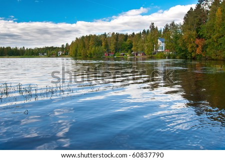 Beautiful photo of finnish lake with houses and summer cottages on the shore.