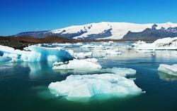 Beautiful photo of Jokulsarlon Glacial lake full of floating icebergs