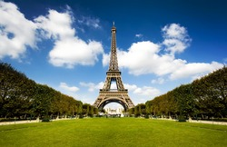 Beautiful photo of the Eiffel tower in Paris with gorgeous colors and wide angle central perspective.