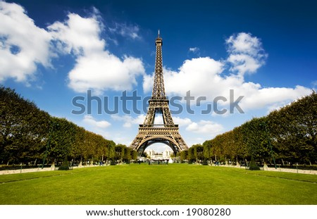 Beautiful photo of the Eiffel tower in Paris with gorgeous colors and wide angle central perspective
