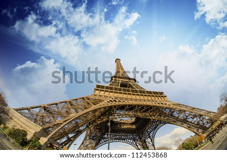 Beautiful photo of the Eiffel tower in Paris with gorgeous sky colors and wide angle perspective, France