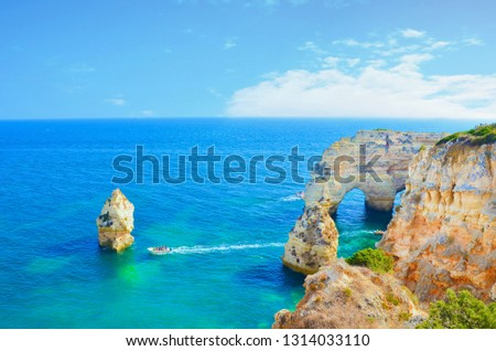 Beautiful picture of the sea rocks and cliffs in the bays of the Atlantic Ocean in Algarve, Portugal taken on a perfect summer day. The portuguese coast is a popular summer vacation destination.