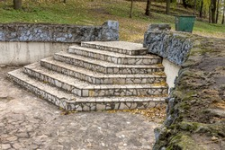 Beautiful picturesque ruins of ancient broken stone stairs. Selective focus with shallow depth of field for the creative design of stage
