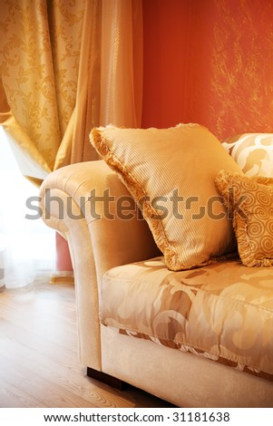 beautiful pillow on a sofa in modern apartment - stock photo