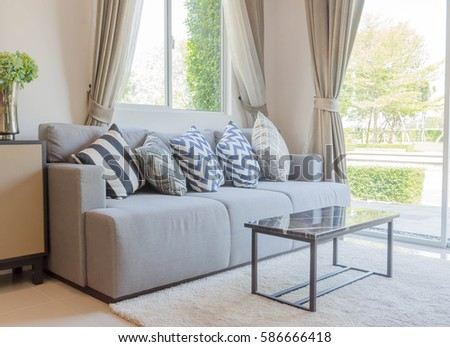 Beautiful pillow on sofa decoration in living room interior #586666418