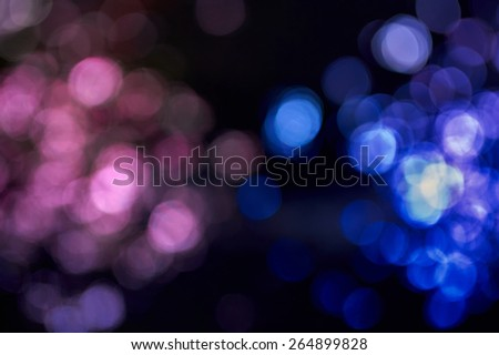 Beautiful pink and blue blurred  lights on dark background