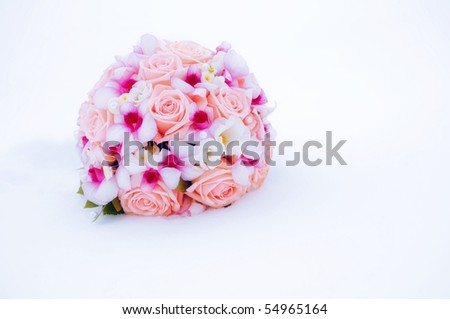 stock photo beautiful pink and purple wedding bouquet on the snow winter