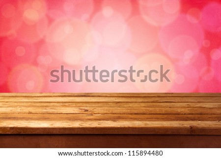 Beautiful pink bokeh background with wooden table