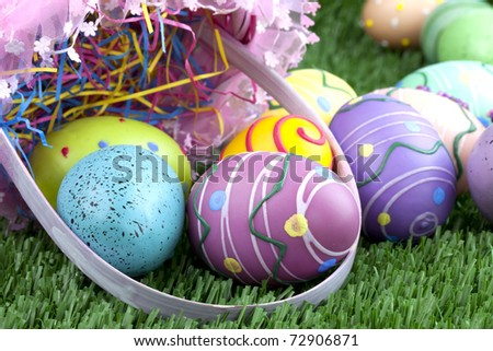 Beautiful pink easter basket with  decorated eggs in green grass