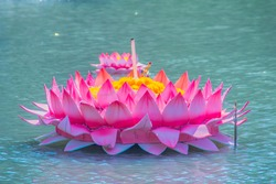 Beautiful pink kratong is floating on the water. Conccept for loy kratongs festival celebrated in Thailand.
