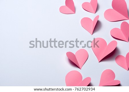Beautiful pink paper hearts on white paper background #762702934