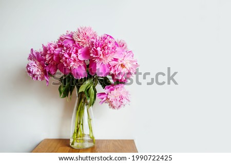 Beautiful Pink Peonies Roses On Wooden Table.