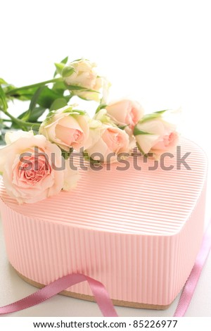 Beautiful pink roses and heart shaped gift box for Valentine's day image