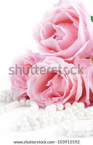 Beautiful pink roses and white pearls