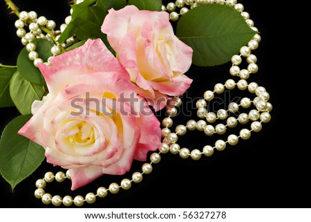 Beautiful pink roses with elegant pearls on a black background, perfect for Mother's Day