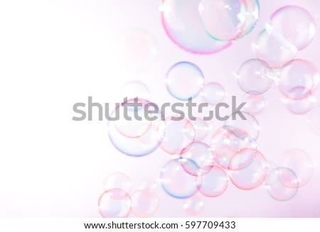 Beautiful pink soap bubbles float background.
