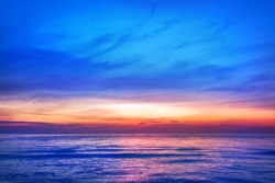 Beautiful pink sunset, blue sky, purple sea background, blurred watercolor sunrise, quiet ocean beach landscape, peaceful morning seascape, idyllic dawn nature, calm soft dusk, gentle sun light glow