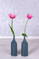 Beautiful pink tulips on grey wall background