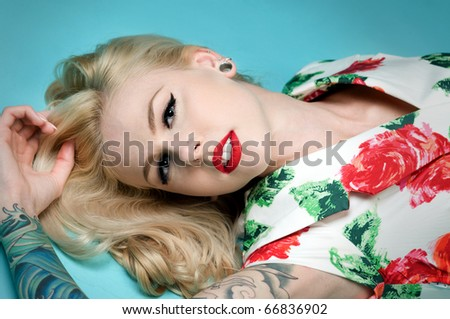 Beautiful pinup girl wearing Christmas dress