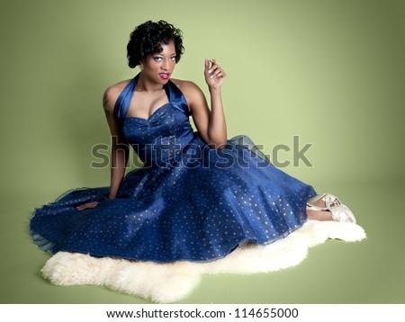 Beautiful pinup model wearing fancy blue dress