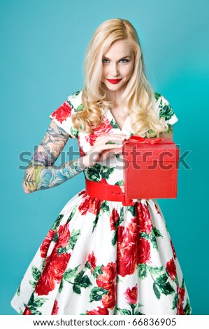 Beautiful pinup model with Christmas gift