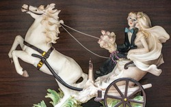 beautiful plaster of paris artefact of lovers on horse chariot