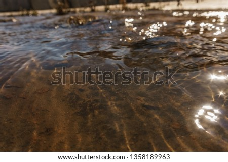 Beautiful play of water and glare from the sun #1358189963