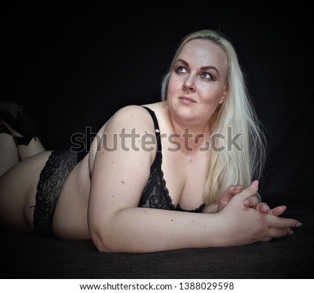 Beautiful plump blonde poses for the camera. Obesity problems close up.