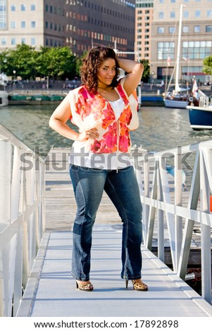 Beautiful plus size woman standing at a marina ramp