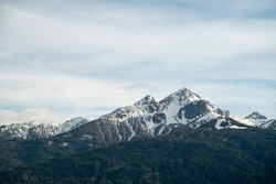 Beautiful pointed snowcapped mountains infront of a sea of the european alps