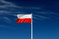 Beautiful Polish flag on a sunny day with blue sky on background