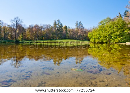 Beautiful pond in the autumn park