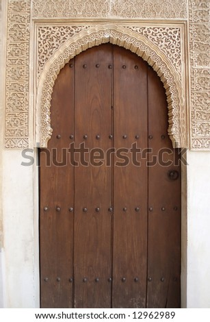 Beautiful portal wirth closed door to the ancient palace Alhambra in Spain